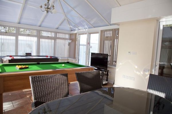 games room with pool table and air hockey