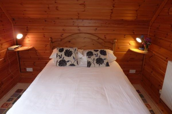 double bed in pine lodge
