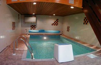 Heated indoor swimming pool with wavejet machine