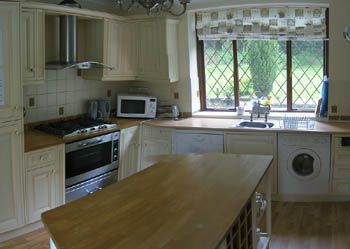 Generaous kitchen, fully equipped, looks out over formal gardens