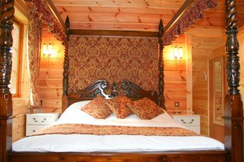 pine lodges or log cbins with a four poster bed