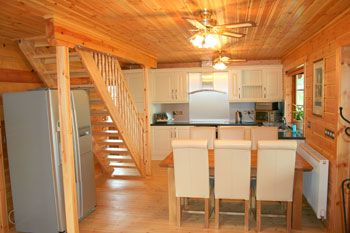 Cosy interior of our luxury pine lodges with hot tub and jacuzzi bath